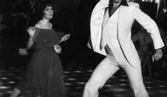 "FILE- This is a  file photo of John Travolta and Karen Gorney dance in a nightclub scene to disco music in Paramount Pictures 1977 film ""Saturday Night Fever"", which explores the restless generation growing up in the 70's.  John Travolta was onto something. Women are most attracted to male dancers who have big, flamboyant moves similar to the actor's trademark style, British scientists say in a new study. (AP Photo/HO, File)"
