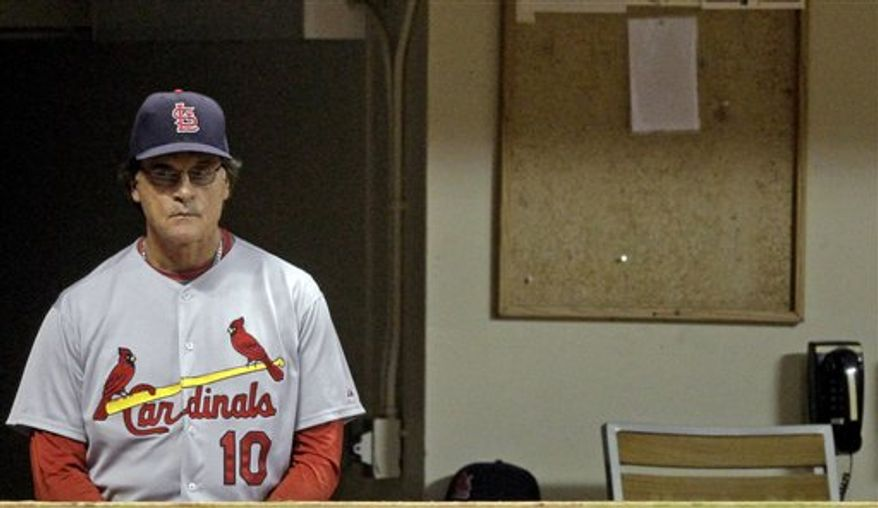 St. Louis Cardinals manager Tony La Russa watches from the dugout during the fourth inning of a baseball game against the Milwaukee Brewers on Wednesday, Sept. 8, 2010, in Milwaukee. The Brewers scored four runs in the inning. (AP Photo/Morry Gash)