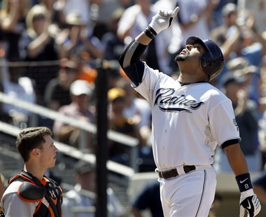San Francisco Giants' Andres Torres celebrates past third baseman Chase Headley after a triple during the first inning of a baseball game in San Diego, Thursday, Sept. 9, 2010. (AP Photo/Chris Carlson)