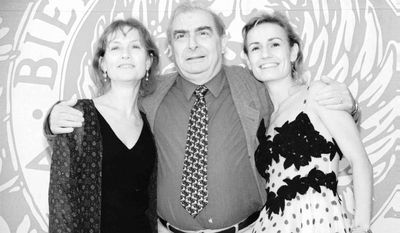 """** FILE ** French film director Claude Chabrol and actresses Isabelle Huppert (left) and Sandrine Bonnaire present their film """"La Ceremonie"""" (""""The Ceremony"""") at the Film Festival in Venice on Sept. 4, 1995. (AP Photo/Luigi Costantini)"""