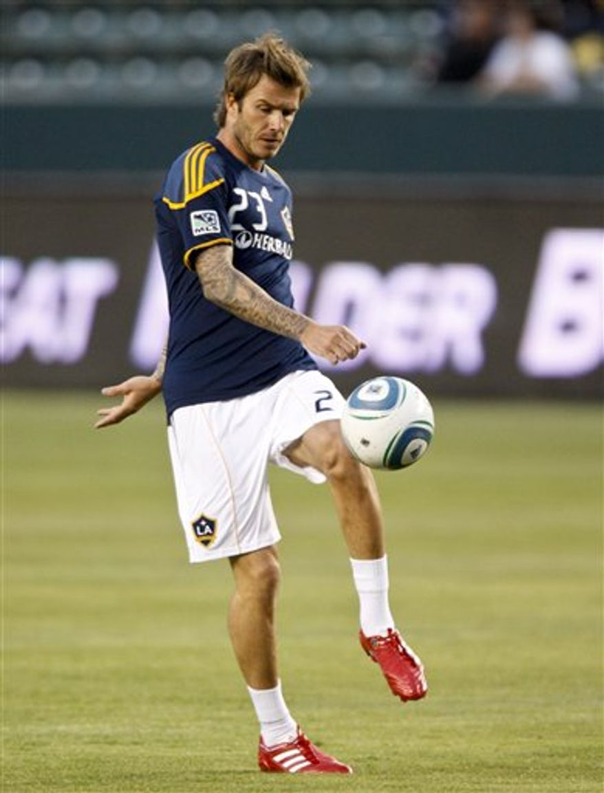 Los Angeles Galaxy midfielder David Beckham stretches before the Galaxy's game against Columbus Crew during an MLS soccer match Saturday, Sept. 11, 2010, in Carson, Calif. (AP Photo/Bret Hartman)