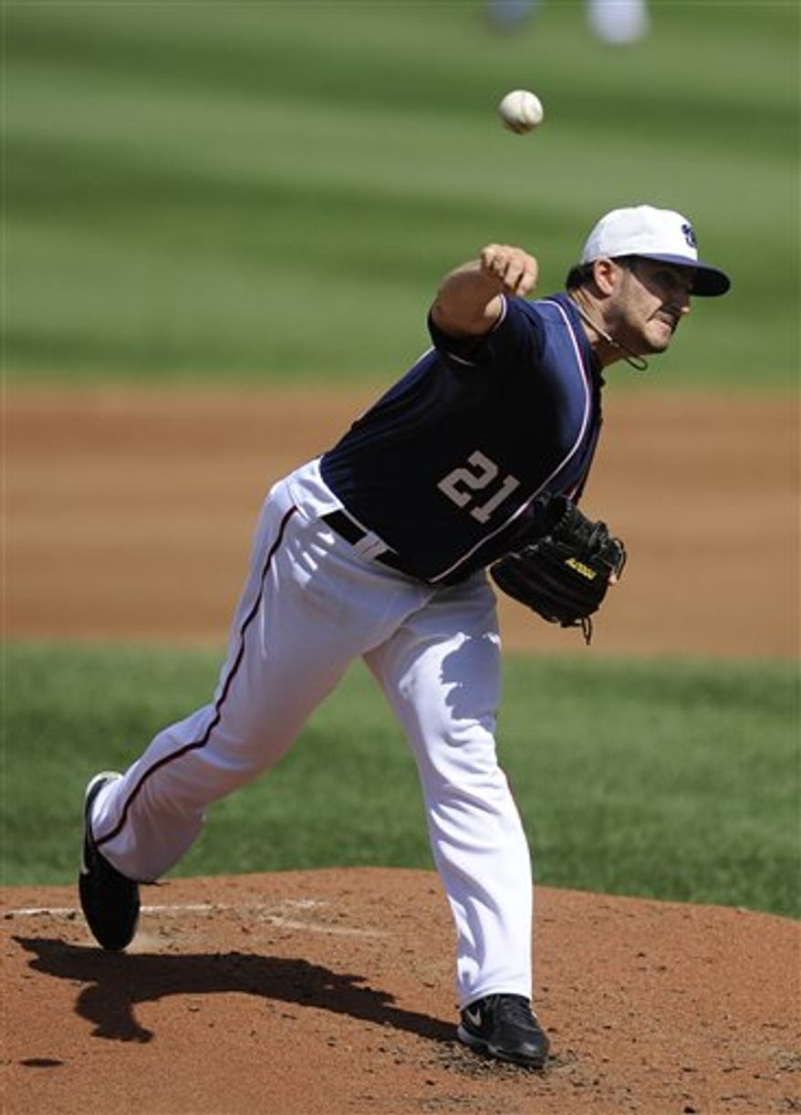Washington Nationals starting pitcher Jason Marquis delivers a pitch during the third inning of a baseball game against the Florida Marlins, Saturday, Sept. 11, 2010, in Washington. (AP Photo/Nick Wass)