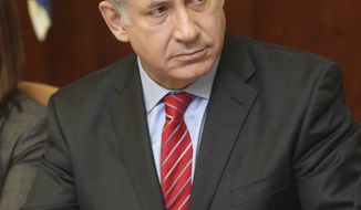 Israeli Prime Minister Benjamin Netanyahu attends the weekly Cabinet meeting in Jerusalem on Sunday, Sept. 12, 2010. (AP Photo/Tara Todras-Whitehill, Pool)