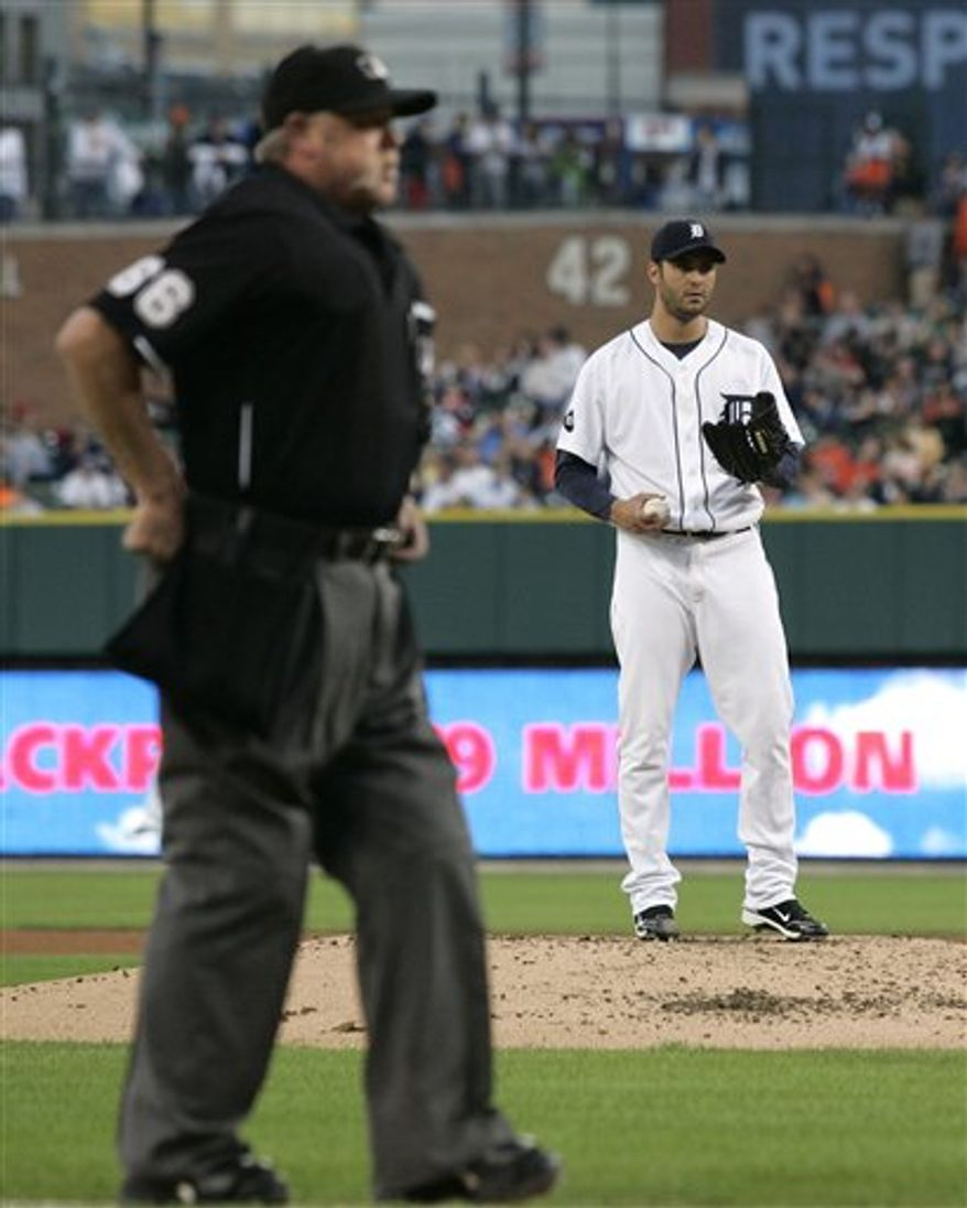 Major League Baseball home plate umpire Jim Joyce, left, calls for the first batter after Detroit Tigers starter Armando Galarraga, right, finished warming up in the first inning of a baseball game against the Baltimore Orioles Friday, Sept. 10, 2010 in Detroit. Joyce and Galarraga are participating in the same game for the first time since Joyce missed a call at first base that cost Galarraga a perfect game on June 2. (AP Photo/Duane Burleson)