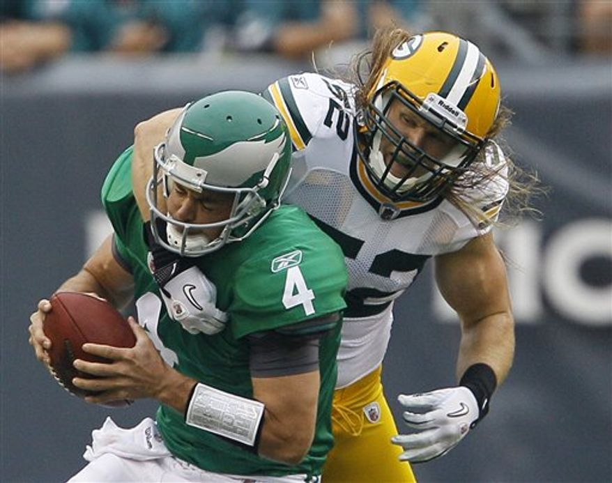 Philadelphia Eagles quarterback Kevin Kolb, left, is chased down and sacked by Green Bay Packers linebacker Clay Matthews in the first half of an NFL football game, Sunday, Sept. 12, 2010, in Philadelphia. (AP Photo/Miles Kennedy)