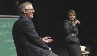 Television political commentator Glenn Beck (left) appears onstage with former Alaska Gov. Sarah Palin in Anchorage, Alaska, on Saturday, Sept. 11, 2010. (AP Photo/Michael Dinneen)