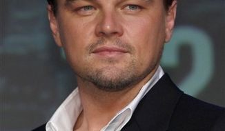 """FILE - In this July 21, 2010 file photo, actor Leonardo DiCaprio poses for photographers during a news conference for  """"Inception"""" in Tokyo, Japan. (AP Photo/Shizuo Kambayashi, file)"""