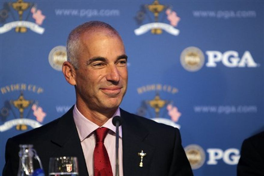 In this photo released by the PGA of America, United States Ryder Cup captain Corey Pavin smiles during a news conference at the New Yor Stock Exchange on Tuesday, Sept. 7, 2010, in  New York.  Pavin announced his captain's pick Tuesday, selecting Tiger Woods, Rickie Fowler, Zach Johnson and Stewart Cink to the team. The Ryder Cup is scheduled to take place from Oct. 1-3 at the Celtic Manor in Wales. (AP Photo/PGA of America, Mike Ehrmann)