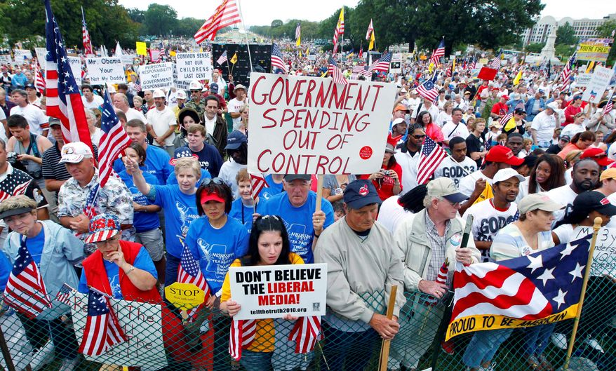 Tea partyers rally at the Capitol in September 2010 to oppose government spending, particularly bailouts and economic policies backed by President Obama. (AP Photo/J. Scott Applewhite)