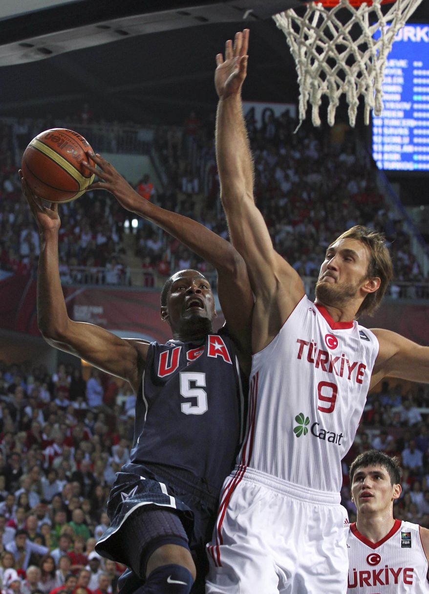 USA's Kevin Durant (left) and Turkey's Semih Erden battle for the ball Sunday during the final of the World Basketball Championship between Turkey and the USA in Istanbul. (Associated Press)