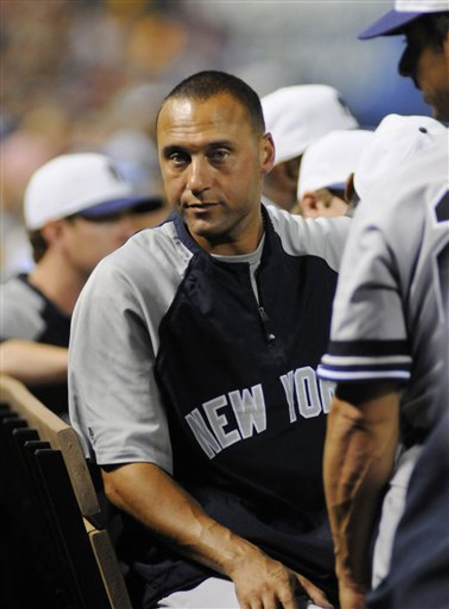 New York Yankees shortstop Derek Jeter and teammates sit on the bench during tghe fourth inning of the baseball game against the Texas Rangers in Arlington, Texas, Saturday, Sept. 11, 2010. Jeter was out of the starting lineup for the game. (AP Photo/Ralph Lauer)