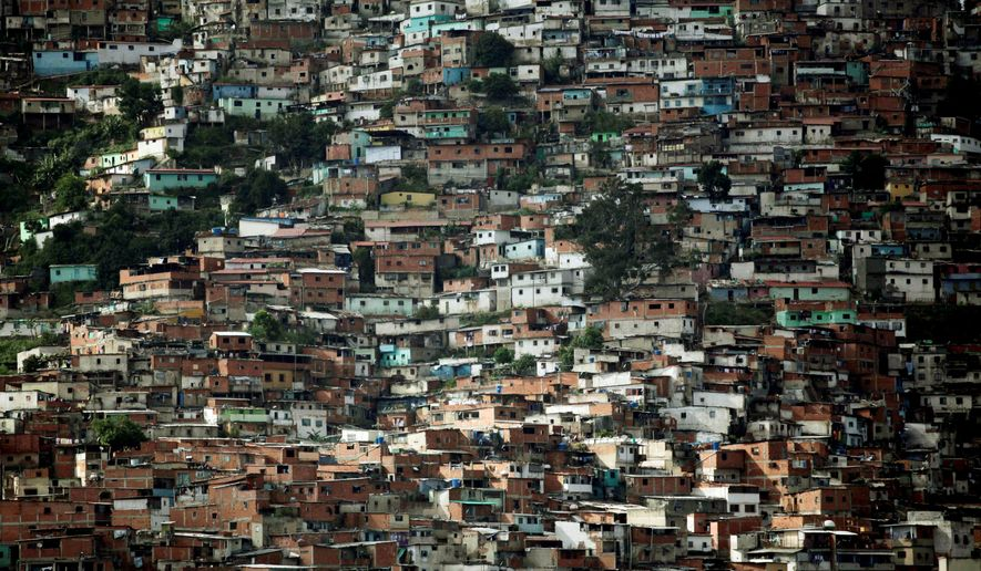 Shacks made of wood scraps and corrugated zinc dominate a slum of Caracas, Venezuela, but the government says it has halved the country's poverty rate. (Associated Press)