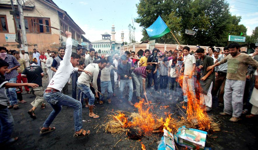 Kashmiri protesters beat an effigy of President Obama after burning it in Srinagar, India. Indian forces battled Kashmiri protesters in the streets of the disputed territory Monday in demonstrations prompted in part by a report of the Koran being desecrated in the United States. (Associated Press)