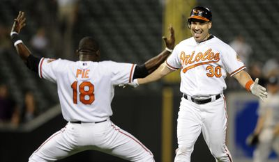 ASSOCIATED PRESS Baltimore Orioles  designated hitter Luke Scott (30) celebrates with Felix Pie (18) after Scott drove in Nick Markakis for the game-winning run during the 11th inning of a baseball game against the Toronto Blue Jays, Monday, Sept. 13, 2010, in Baltimore. The Orioles won 4-3 in 11 innings.
