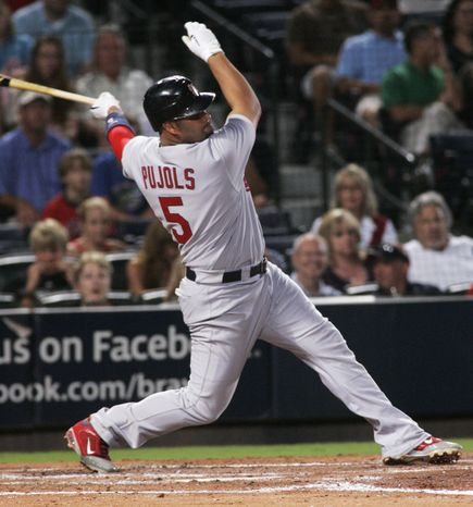 St. Louis Cardinals first baseman Albert Pujols grounds out during the third inning of the Cardinals' 7-3 road win Sunday against the Atlanta Braves. Pujols homered twice in the win. (AP Photo/John Amis)