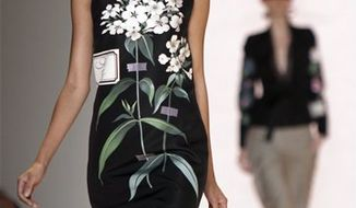 The spring 2011 collection of designer Carolina Herrera is modeled during Fashion Week in New York, Monday, Sept. 13, 2010. (AP Photo/Richard Drew)