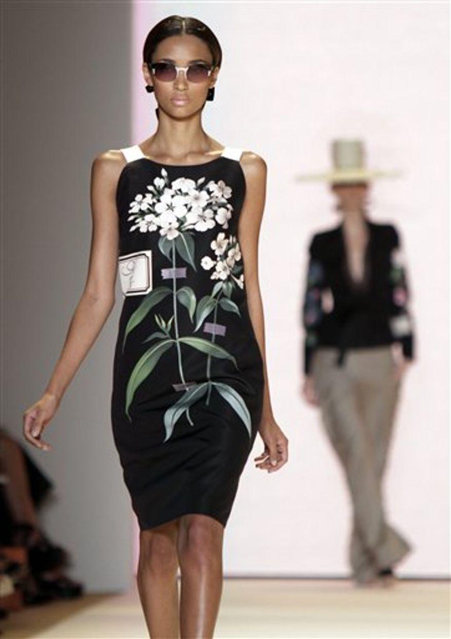 The spring 2011 collection of designer Carolina Herrera is modeled during Fashion Week in New York, Monday, Sept. 13, 2010. (AP Photo/Richard Drew)