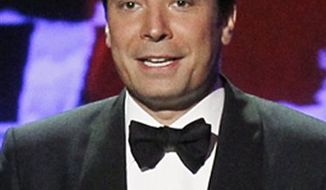 FILE - In this Aug. 29, 2010 file photo, host Jimmy Fallon introduces a presenter during the 62nd Primetime Emmy Awards  in Los Angeles. (AP Photo/Chris Carlson, file)