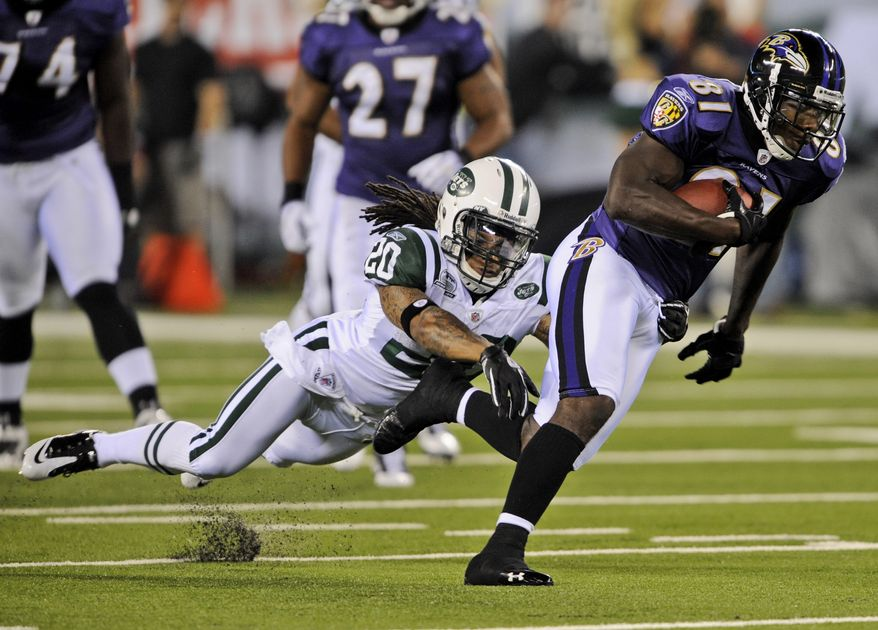 ASSOCIATED PRESS Baltimore Ravens  wide receiver Anquan Boldin (81) breaks a tackle by New York Jets' Kyle Wilson (20) during the first quarter of an NFL football game at New Meadowlands Stadium in East Rutherford, N.J., Monday, Sept. 13, 2010.