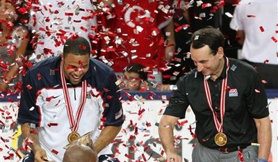USA head coach Mike Krzyzewski cuts down the net as he celebrates after the final of the World Basketball Championship between Turkey and the USA, Sunday, Sept. 12, 2010, in Istanbul.  USA won the match 81-64. (AP Photo/Thanassis Stavrakis)