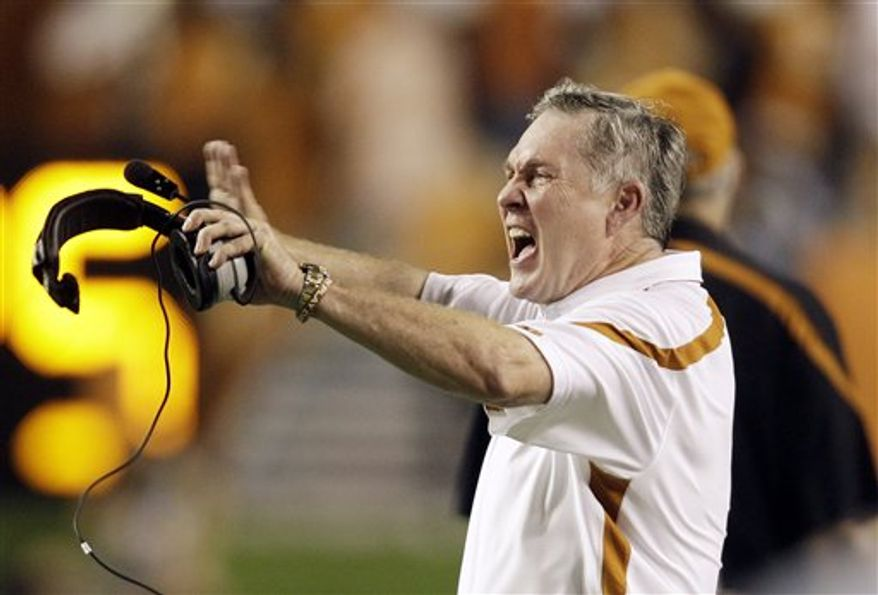 Texas coach Mack Brown argues an officials call during the third quarter of an NCAA college football game against Wyoming, Saturday, Sept. 11, 2010 in Austin, Texas. Texas won 34-7. (AP Photo/Eric Gay)