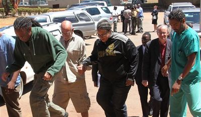 US doctors, from left, Gregory Reinard, David Greenburg, Gloria Cox Cronwell, New Zealand doctor Reid Andrew John,  and US doctor Anthony Eugene Jones, appear at the magistrates courts in Harare, Monday, Sept. 13, 2010. A Zimbabwean court has freed on bail four Americans arrested and accused of treating AIDS patients without proper medical licenses. A magistrate ordered the six health workers, who included a New Zealand national and a Zimbabwean, to pay a $200 bail and to reappear in court on Sept. 27. They could face a fine and deportation. The court ordered them to surrender their passports and live at their Mother of Peace Orphanage outside Harare until their trial. (AP Photo/Tsvangirayi Mukwazhi)