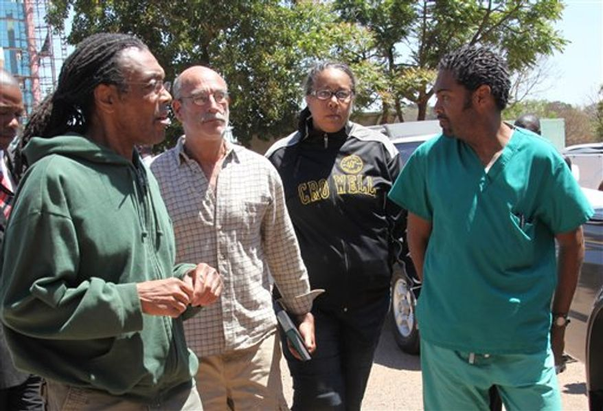 American  doctors, from left, Gregory Reinard, David Greenburg, Gloria Cox Cronwell and Anthony Eugene Jones appear at the magistrates courts in Harare, Zimbabwe Monday, Sept. 13, 2010. The four were  charged under Zimbabwean laws for practising medicine and selling drugs without a licence. They were released on bail after paying $200 each and could face a fine and deportation. The California church that sponsors their work says the church has been working in Zimbabwe for more than a decade and that this is the first time licensing questions have been raised. (AP Photo/Tsvangirayi Mukwazhi)