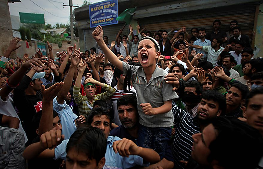 A young Kashmiri boy shouts slogans during a protest on the outskirts of Srinagar, India, Monday, Sept. 13, 2010. Indian forces battled Kashmiri protesters in the streets of the disputed territory Monday in demonstrations fueled in part by a report of the Quran being desecrated in the United States. (AP Photo/Altaf Qadri)