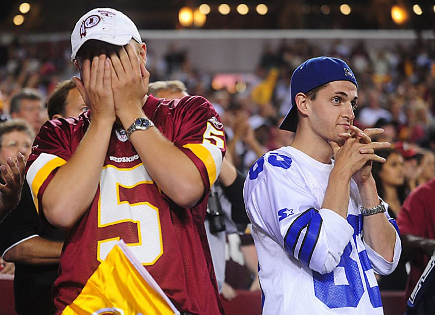 A Washington Redskin and Dallas Cowboy fan watch in the final second of their game at FedEx Field in Landover, Maryland on September 12, 2010. The Redskins defeated the Cowboys 13-7.   UPI/Kevin Dietsch
