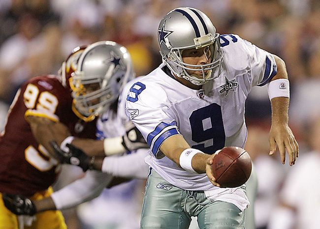 Dallas Cowboys quarterback Tony Romo turns to hand off the ball during the second half of an NFL football game against the Washington Redskins in Landover, Md., on Sunday, Sept. 12, 2010.  (AP Photo/Evan Vucci)