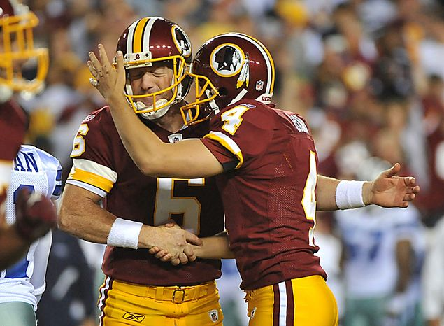 Washington Redskins kicker Graham Gano (R) celebrates with Josh Bidwell after kicking a 29-yard field goal against the Dallas Cowboys during the first quarter at FedEx Field in Landover, Maryland on September 12, 2010.  UPI/Kevin Dietsch