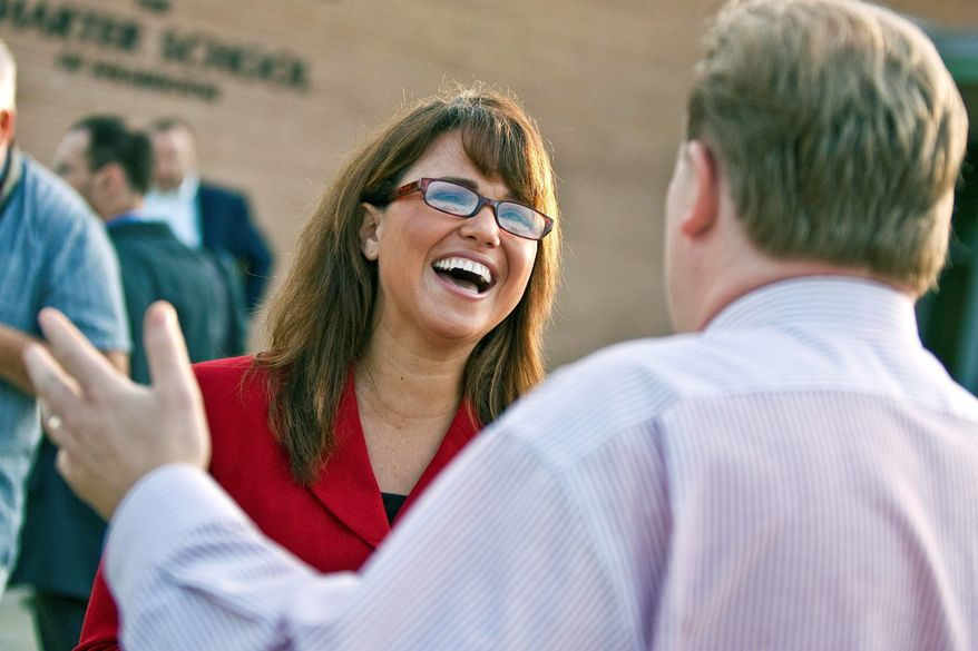 Senate candidate Christine O'Donnell chats with voters in Wilmington, Del., on Tuesday. Ms. O'Donnell took on nine-term Rep. Michael N. Castle in the Republican primary for a U.S. Senate seat. (AP Photo)