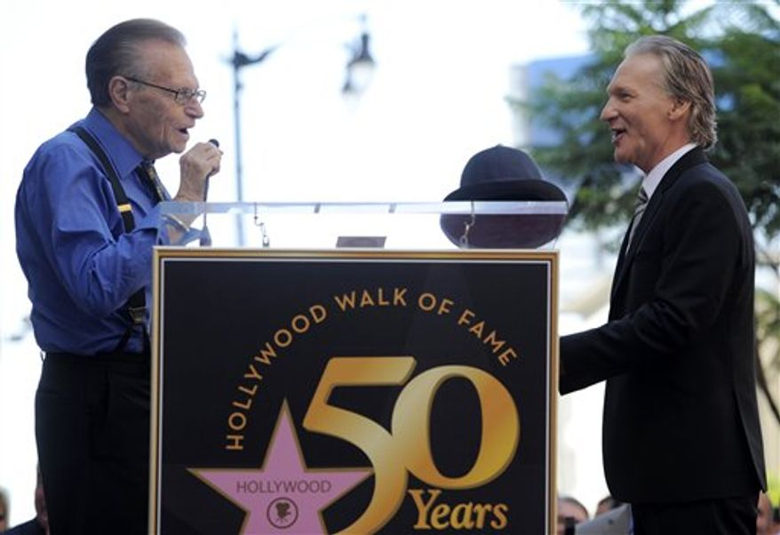 Comedian and television host Bill Maher, right, looks on as Hollywood Chamber of Commerce President/CEO Leron Gubler begins a ceremony to award Maher with a star on the Hollywood Walk of Fame in Los Angeles, Tuesday, Sept. 14, 2010. (AP Photo/Chris Pizzello)