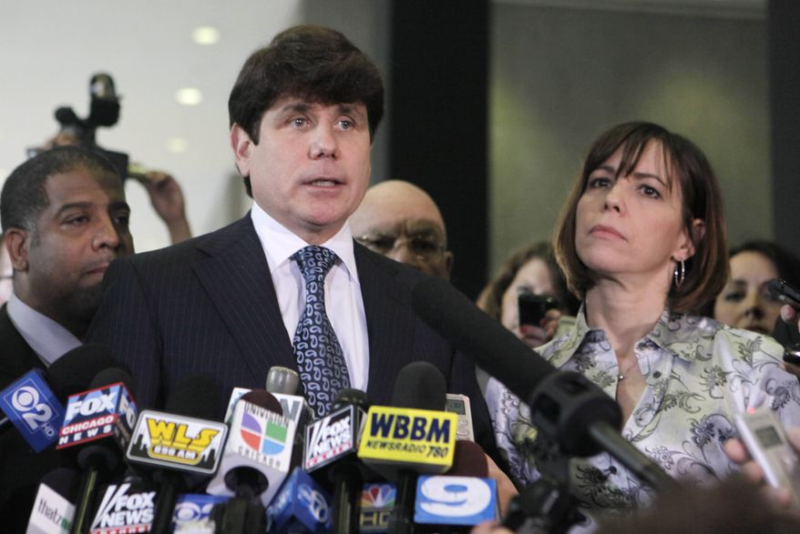 ** FILE ** Former Illinois Gov. Rod Blagojevich talks to members of the media at the federal building in Chicago on Aug. 17, 2010, after a jury found him guilty of one count of lying to federal agents. His wife, Patti, is at right. (AP Photo/Kiichiro Sato, File)