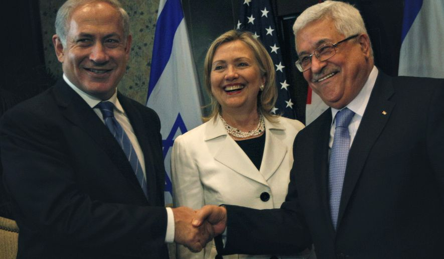 Israeli Prime Minister Benjamin Netanyahu, left, shakes hands with Palestinian Authority President Mahmoud Abbas, second right, joined by Secretary of State Hillary Rodham Clinton, center during bilateral talks at the Red Sea resort of Sharm el Sheik, Egypt Tuesday Sept. 14, 2010. (AP Photo/Nasser Nasser)