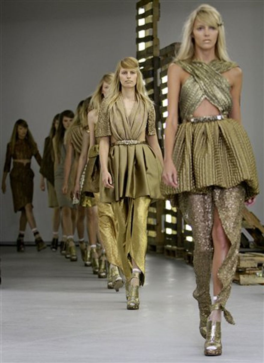 The Rodarte spring 2011 collection is modeled Tuesday, Sept. 14, 2010, during Fashion Week in New York. (AP Photo/David Goldman)