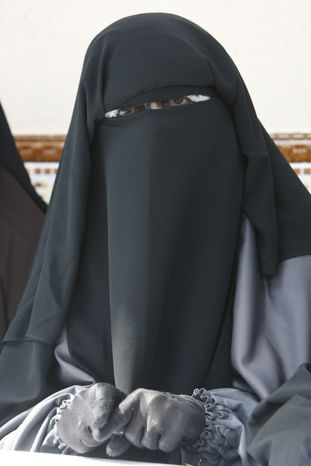 This May 18, 2010, file photo shows Oum Al Khyr Charlton, gesturing while addressing reporters during a press conference held in Montreuil, east of Paris. A ban on the burqa-style veil, voted on Tuesday in the Senate, would affect only a tiny minority of Muslim women, estimated at less than 2,000, making it far less controversial than France's 2004 ban on Muslim headscarves in classrooms, which proliferated in heavily immigrant neighborhoods.(AP Photo/Remy de la Mauviniere, file)