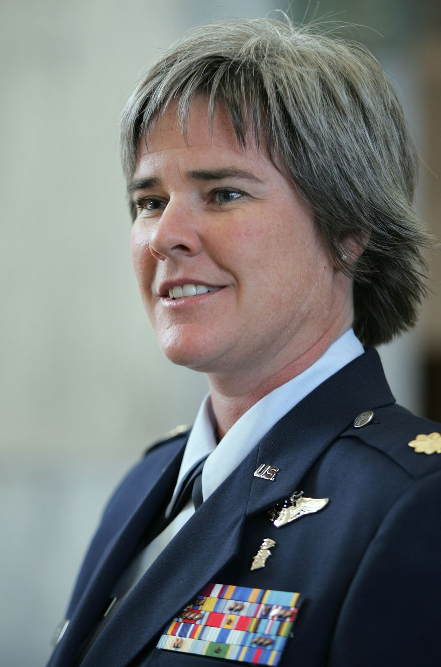 ** FILE ** Maj. Margaret Witt of the U.S. Air Force Reserve is seen in U.S. District Court in Tacoma, Wash., in 2006 after a hearing in her case challenging her dismissal for being a lesbian. (AP Photo/John Froschauer, File)