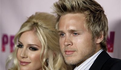 "** FILE ** In this Nov. 16, 2009, file photo, Heidi Montag and Spencer Pratt are shown at an appearance for their book ""How To Be Famous"" at Borders Books in New York. (AP Photo/Charles Sykes, file)"