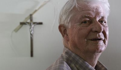 Deacon Jack Sullivan of Marshfield, Mass., whose instantaneous relief from pain after praying to Cardinal John Henry Newman has been deemed a miracle by the Roman Catholic Church, will attend Newman's beatification in England on Sunday. (AP Photo/Steven Senne)
