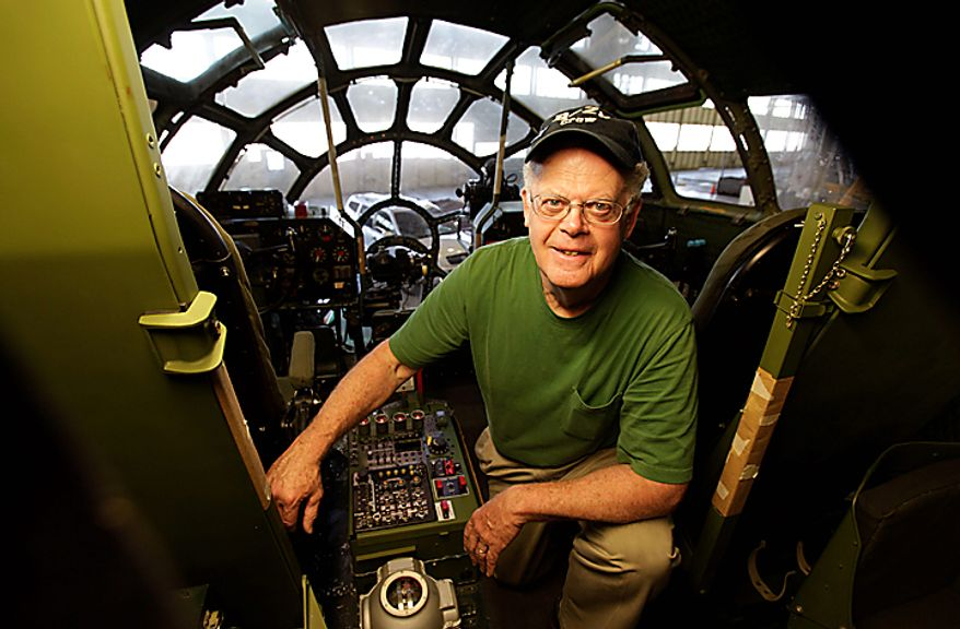 "In this photo taken July 14, 2010, Dale Thompson, a volunteer with the Museum of Flight, poses for a photo inside a Boeing Co. B-29 Super Fortress that he is helping restore at Boeing Co.'s historic ""Plant 2"" in Seattle. After giving birth to some of the world's most significant aircraft, the outdated facility is scheduled to be torn down this fall, and a new home for the work of restoring the B-17 and other planes will need to be found. (AP Photo/Ted S. Warren)"