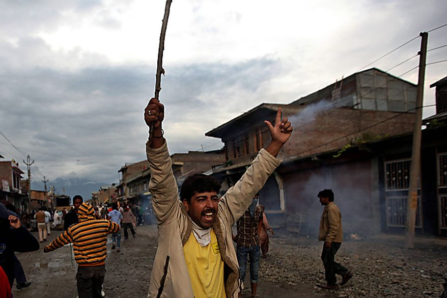 A Kashmiri Muslim protester shouts slogans during a protest in Srinagar, India, Tuesday, Sept. 14, 2010. Indian police patrolled the streets of Kashmir on Tuesday, threatening to shoot anyone defying a rigid curfew in the disputed region a day after 19 people died in battles between troops and protesters. (AP Photo/Dar Yasin)