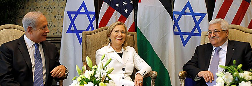 U.S. Secretary of State Hillary Rodham Clinton, center, meets with Israeli Prime Minister Benjamin Netanyahu, left, and Palestinian President Mahmoud Abbas, in Sharm El-Sheikh, Egypt, Tuesday, Sept. 14, 2010. Leaders are meeting for Mideast peace talks. (AP Photo/Alex Brandon, Pool)