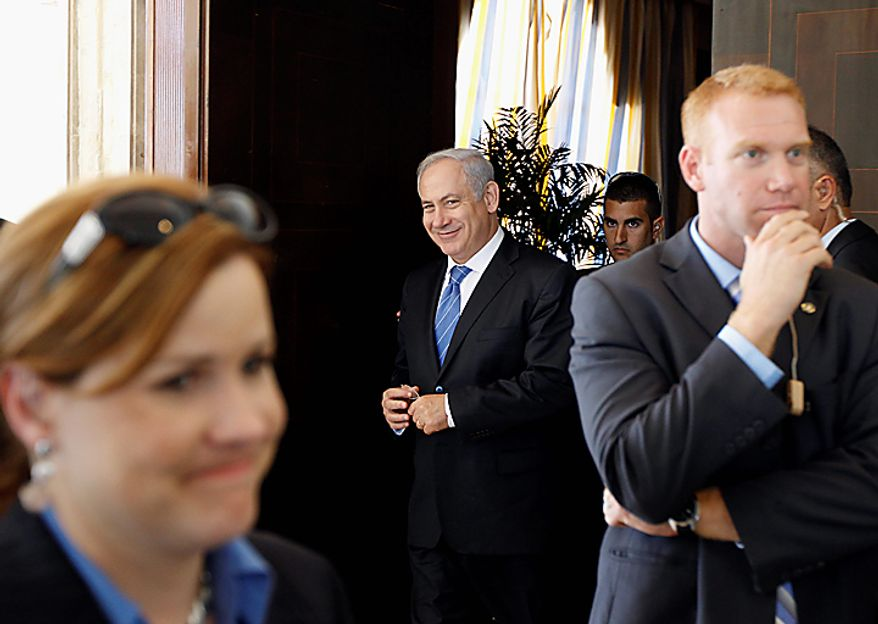 Israeli Prime Minister Benjamin Netanyahu, center, walks to a meeting with Secretary of State Hillary Rodham Clinton, Palestinian president Mahmoud Abbas, and U.S. Special Envoy for Middle East Peace former Sen. George Mitchell, unseen, in Sharm El-Sheikh, Egypt Tuesday, Sept. 14, 2010. Clinton is in the region for Mideast peace talks. (AP Photo/Alex Brandon, Pool)