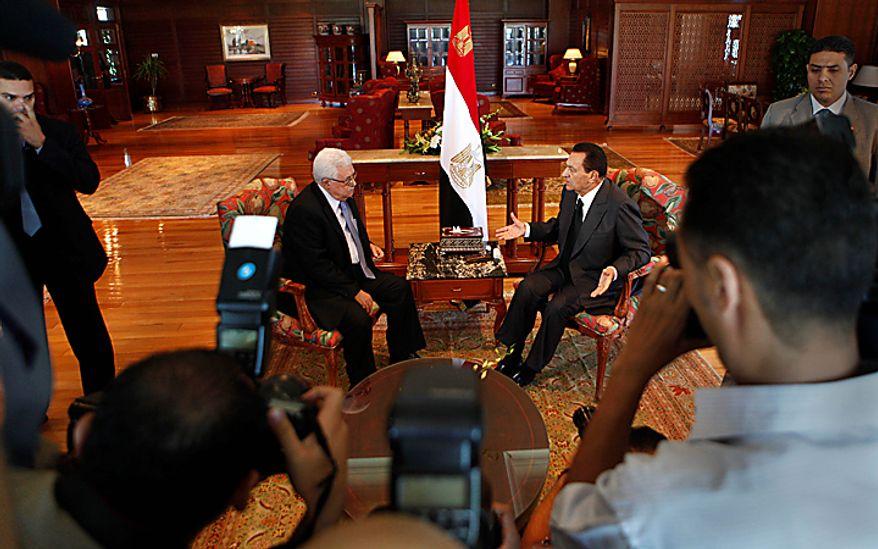 Cameramen film Egyptian President Hosni Mubarak, right, meeting with Palestinian President Mahmoud Abbas at the Red Sea resort of Sharm el-Sheikh, Egypt, Tuesday, Sept. 14, 2010, as Egypt hosts the second round of Israeli-Palestinian peace talks. (AP Photo/Amr Nabil)