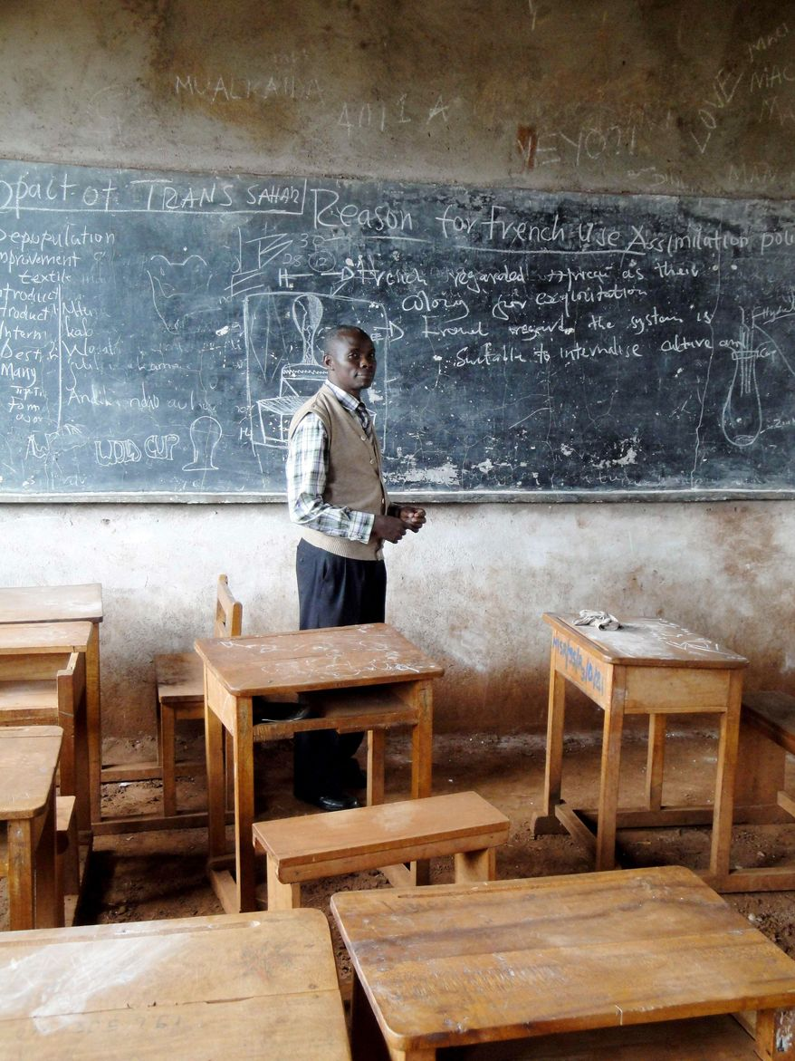 Sygifrid Saweru is headmaster of Msaranga Secondary School, one of dozens of secondary schools built in the region to accommodate a surge in primary school graduates. The desks are on dirt floors because the building is only half-finished. (Associated Press)