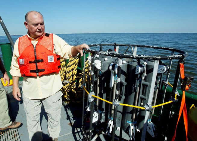 ASSOCIATED PRESS Retired Coast Guard Adm. Thad Allen on Tuesday looks over a Conductivity-Temperature-Depth carousel, which is used to assist Deepwater Horizon oil spill response efforts by capturing subsurface water samples on the Gulf of Mexico near the coast of Louisiana.