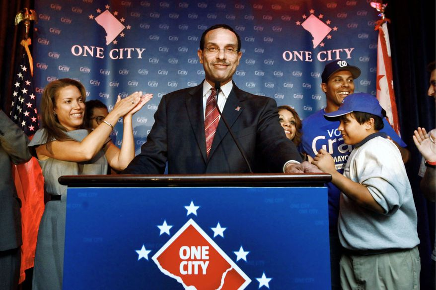 ASSOCIATED PRESS PHOTOGRAPHS D.C. Council Chairman Vincent C. Gray, presumed to be the next mayor, makes a victory speech Wednesday surrounded by members of his family, including daughter Jonice Gray Tucker. He reiterated that jobs and school reform were his priorities.
