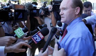 """Delaware Democratic Senate candidate Chris Coons talks with reporters Wednesday in Wilmington. Mr. Coons will face long-shot, """"tea party""""-backed Republican nominee Christine O'Donnell in the November election."""
