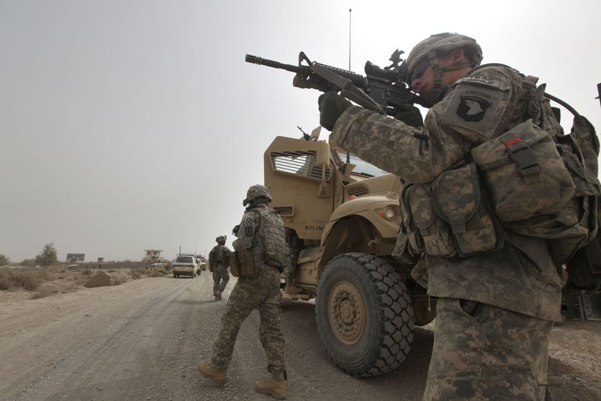 ** FILE ** U.S. Army Spc. Cody Borawa of Unadilla, N.Y., of Tactical Command Post, HQ Company, 2-502 Infantry, 101st Airborne Division, looks for a Taliban position during a day of joint missions with the Afghan army in the Zhari district of southern Afghanistan's Kandahar province on Aug. 26, 2010. (AP Photo/Brennan Linsley, File)